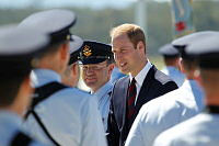 His Royal Highness, the Duke of Cambridge speaks to a member of the Air Force Band after reviewing the Royal Guard at RAAF Base Amberley.
