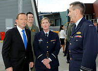 The Prime Minister, The Hon. Tony Abbott MP (left), discussing the F-35A Lightning II aircraft with the Program Manager for New Combat Capability, Air Commodore Cath Roberts, CSC and the Chief of Air Force, Air Marshal Geoff Brown, AO.