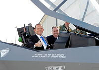 The Chief of Air Force, Air Marshal Geoff Brown, AO gives the Prime Minister, The Hon. Tony Abbott MP, a tour of the cockpit of the 'mock-up' of an F-35A Lightning II aircraft at Defence Establishment Fairbairn.