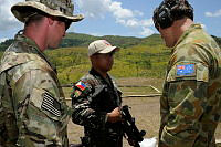 A Philippines soldier (middle) receives training from an Australian soldier from the 2nd Commando Regiment (right) and a United States Marine Corps memberduring marksmanship training at Fort Magsaysay, Philippines, during Exercise Balikatan (faces have been digitally obscured to protect the identity of Special Forces troops).