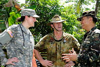 United States Army Veterinary Corps officer, Captain Emily Elser (left) and Australian Army veterinarian, Captain Kendall Crocker, discuss the Exercise BALIKATAN veterinary civil assistance program with Philippines Army, Commander Southern Luzon Command, General Cesar Ordoyo, near Legazpi, Philippines