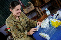 Australian Army preventive medicine technician, Private Carly Callaghan sorts medications for dissemination to patients at the Cooperative Health Engagement at Tacloban as part of Exercise BALIKATAN