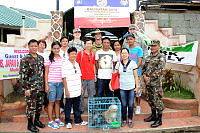 Members of the veterinary contingent working on Exercise BALIKATAN pose for a photo out the front of Fisherman's Village Elementary School at the conclusion of the Cooperative Health Engagement in Tacloban.
