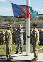 The old Commander Joint Operations flag is lowered for the last time before being presented to Lieutenant General Ash Power.