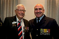 World War II veteran Mr Bill Evens (left) with Royal Australian Air Force officer Flight Lieutenant Mark Schmidt during a dinner held at the Park Royal Hotel, Sydney.