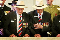 Australian D-Day veterans Fred Riley (left) and Bob Cowper pay their respects during the remembrance ceremony at the Anzac Memorial in Hyde Park, Sydney.