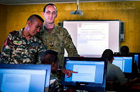 Australian Army soldier Sergeant Benjamin McCarthy from the Defence Cooperation Program, oversees Timor-Leste Defence Force soldier Corporal Sixto Sarmento, during a communications class at the Specialist Training Centre in Metinaro, Timor-Leste.