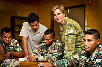 Royal Australian Air Force officer Flight Lieutenant Karen Hunter (second from right), a numeracy trainer from the Defence Cooperation Program, engages with Timor-Leste Defence Force soldiers during a training session at the Specialist Training Centre in Metinaro, Timor-Leste.
