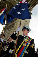 Royal Australian Navy guardsman Petty Officer Donald Blackley performs the role of flag bearer during the Eternal Flame ceremony at the Arc De Triomphe, Paris.