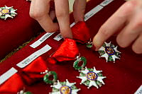 Legion of Honour medals are prepared before being presented to veterans of D-Day at a ceremony in Caen, France.