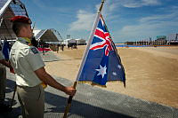 A French serviceman holds the Australian National Flag during a service commemorating the 70th anniversary of the D-Day landings on Sword Beach in Ouistreham, France.