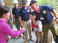 Lieutenant Colonel John Cronin (right) of the Australian Army meets staff at an orphanage on the outskirts of Da Nang city that was refurbished by US Army Engineers and ADF personnel.