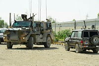 A Bushmaster Protected Mobility Vehicle and Up-Armoured SUV during a task at Camp Hero, Kandahar, Afghanistan.