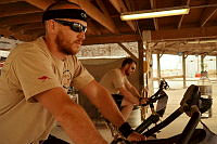 Flight Lieutenant Ryan Ginty (left) and Flight Lieutenant Joel Mortimer from Heron Rotation-14 pedal through the heat during the Dawn Until Dusk challenge for Legacy at Kandahar Airfield.