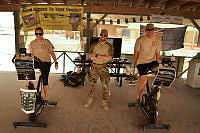 Flight Lieutenant Janelle Sheridan, Flight Lieutenant Joel Mortimer and Flight Sergeant Andrew Earl bring home the final leg of the Dawn Until Dusk challenge for Legacy at Kandahar Airfield.