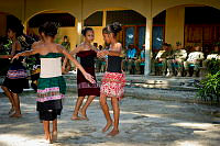 Comoro Intermediate School students perform a traditional dance for Australian, United States and Timorese defence force members at the opening of the school's newly built kitchen at the Comoro Intermediate School in Dili, East Timor, during Exercise Pacific Partnership 2014.