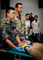 Royal Australian Navy medical officer Lieutenant Lin Hu (right) and New Zealand Army medical officer Captain David Greenhough, conduct skills development in disaster response and life saving trauma management with local Timorese medical practitioners, in Dili, Timor-Leste, during Exercise Pacific Partnership 2014.