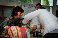 Royal Australian Navy medical officer Lieutenant Commander Victoria Caton (left), conducts newborn care classes with local Timorese medical practitioners, in Dili, Timor-Leste, during Exercise Pacific Partnership 2014.