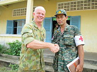 Lieutenant Colonel John Cronin thanks General Mey Thunnara of the Royal Cambodia Armed Forces Health Brigade for their assistance during a free medical clinic conducted under the auspices of Pacific Partnership 14 at The Hun Sen Primary School in Sihanoukville.