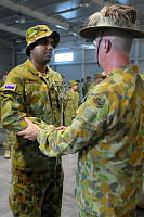 Lance Corporal Manjula Gamage (left) part of Force Communications Unit-10, is congratulated by Major General Craig Orme, Commander Joint Task Force 633, on a job well done.