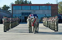 2nd Commando Regiment personnel form an Honour Guard as part of the Ramp Ceremony for Lance Corporal Todd Chidgey.