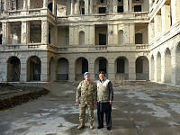 Squadron Leader Robert Saunders in a former Afghan Palace in Kabul with a local driver while deployed to Operation Palate II.
