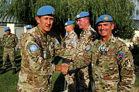 Brigadier Bill Date, Senior Military Advisor to the United Nations Assistance Mission in Afghanistan presents Squadron Leader Saunders with his United Nations and Afghanistan Campaign Medal after his deployment to Operation Palate II.