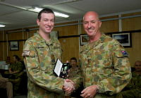 Flight Lieutenant Anthony Erman receives his Australian Active Service Medal from Commander Joint Task Force 633 Major General Craig Orme at Al Minhad Air Base, UAE.