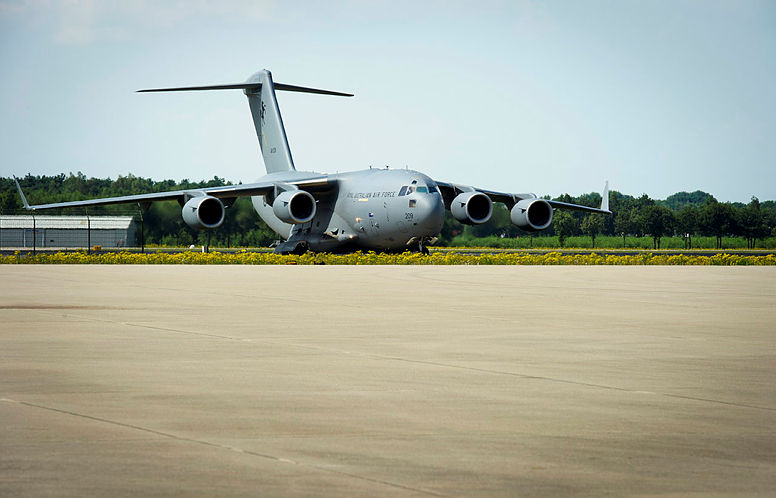 A Royal Australian Air Force C-17A Globemaster, carrying the remains of victims from the MH-17 tragedy, arrives at Eindhoven Airfield, the Netherlands.