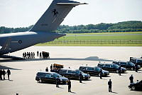 An MH-17 victim is carried by pallbearers from a Royal Australian Air Force C-17A Globemaster by Netherlands Defence Force personnel at Eindhoven Airfield in the Netherlands.