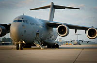 Two Royal Australian Air Force C-17A Globemasters bound for Kharkiv International Airport in the Ukraine wait to be loaded with cargo at Eindhoven Airfield in the Netherlands during Operation Bring Them Home.