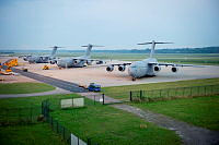 Three Royal Australian Air Force C-17A Globemasters share the ramp at Eindhoven Airport in the Netherlands during Operation Bring Them Home.