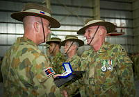 Commander Joint Task Force 633 Major General Craig Orme presents Private Eric Goudswaard with a Commander's Silver Commendation during the Transfer of Authority and medals parade at Al Minhad Air Base.