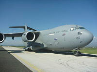 A Royal Australian Air Force C-17A Globemaster strategic airlift aircraft is seen at Tirana airport, Albania, as it awaits the loading of military stores destined for delivery to northern Iraq.