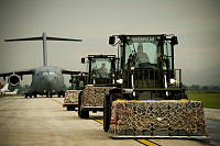 Crates of military stores are loaded onto a Royal Australian Air Force C-17 Globemaster at Tirana Airport, Albania.
