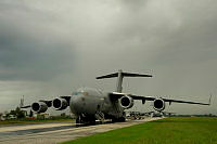 A Royal Australian Air Force C-17 Globemaster waits for the second load of military stores to be loaded at Tirana Airport, Albania.