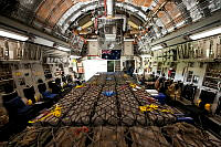 A Royal Australian Air Force C-17A Globemaster aircraft is loaded with 50 tonnes of military stores at Tirana Airport, Albania, prior to delivery to Erbil in northern Iraq.