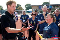 His Royal Highness Prince Harry congratulates Royal Australian Navy Leading Seaman Boatswain's Mate Kirsty-Lee Brown who threw the gold medal-winning Javelin and won the first medal during the Invictus Games in London on September 8.