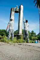 Members of HMAS CHOULES ship's company put the finishing touches to the former Catholic Mission Church bell during a community assistance project undertaken as part of Operation RENDER SAFE 14 in Torokina, Bougainville.