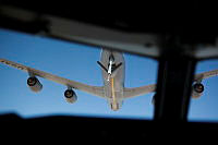 A view from the cockpit of a Royal Australian Air Force E-7A Wedgetail Airborne Early Warning and Control aircraft as it prepares to refuel mid-air from a United States Air Force KC-135 Stratotanker during a mission over Iraq.