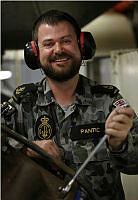 Leading Seaman Marine Technician Luke Pantic smiles as he works in the Engine Room of HMAS Success while in the Middle East Region during Operation MANITOU.
