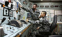 Leading Seaman Marine Technician Luke Pantic (left) instructs Seaman Marine Technician John Ramos during Engineering Casualty Control Drills (ECCDs) in the Machinery Control Room onboard HMAS Success while sailing in the Middle East Region as part of Operation MANITOU.