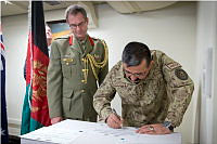 Director General Planning, Policy and Operations - Ministry of Interior, Major General Naimatullah Haidari signs the official documents that begin the first deliveries of Australian-made GREENGUM force protection systems to the Afghan National Army, Afghan National Police and the Afghan National Directorate of Security at the Australian Embassy in Kabul, Afghanistan.