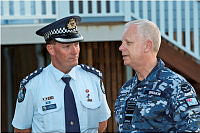 Chief of the Defence Force, Air Chief Marshal Mark Binskin, AC, talks with Inspector Kev Guteridge of the Queensland Police during a visit to Yeppoon in the wake of Cyclone Marcia.
