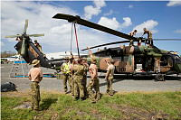 Australian Army members unfold the main rotor of an S-70 Black Hawk helicopter and prepare it for flight at Vanuatu's international airport during Operation Pacific Assist 2015.