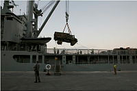 Members of the Ship's Army Detachment of the Royal Australian Navy's heavy-lift ship HMAS Tobruk unload an Army Unimog truck onto the wharf at Port Vila, Vanuatu on March 23, 2015.