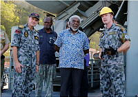 Vanuatu Prime Minister Joe Natuman is shown the capabilities of HMAS Tobruk while the ship was docked at Port Vila on March 23, 2015.