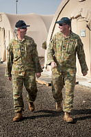 Warrant Officer (WOFF) Rick (left) walks through the Australian tent lines at Air Task Groups main operating base in the Middle East Region with his cousin WOFF Kevin. WOFF Rick hands over the role of Air Task Group Strike Warrant Officer Engineering (WOE) to his cousin and in doing so will ensure one year of continuous service in Strike WOE position by members of the same family.