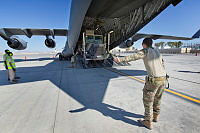 A Mack MC3 heavy utility truck is loaded onto a Royal Australian Air Force C-17 Globemaster heavy transport aircraft at Kandahar Air Field, Afghanistan. The aircraft's mission is to redeploy Australian Defence Force personnel and equipment, including two Mack MC3 heavy utility trucks, following the closure of Camp Baker.