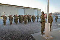 The Australian national flag is lowered for the final time during a parade to commemorate the closure of Camp Baker at Kandahar Air Field in Afghanistan.